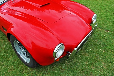 Top front view of the anglo-american red vintage sports car