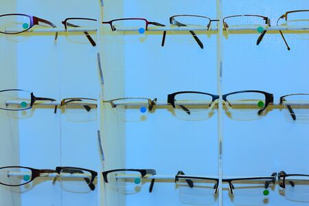 Shelves with ladies glasses at optician shop Stock Photo - 9789738