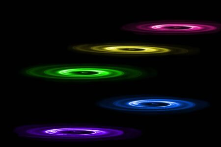 Five round multicolored objects disappearing in the dark Stock Photo - 9627916