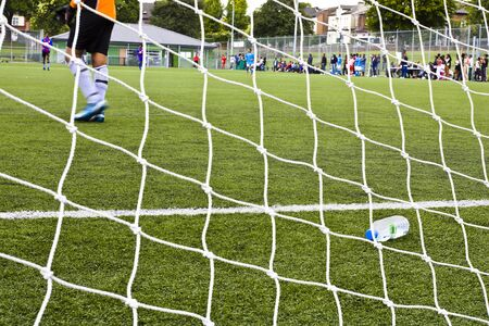 football pitch: View of football field and goalkeeper Editorial