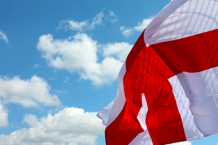English banner waving in the blue sky Stock Photo