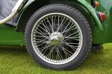 Rear left wheel of an old classic car Stock Photo