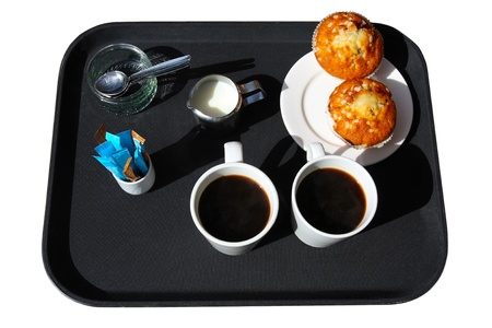 consumables: Black tray with 2 cups of coffee,milk  and cookies isolated Stock Photo