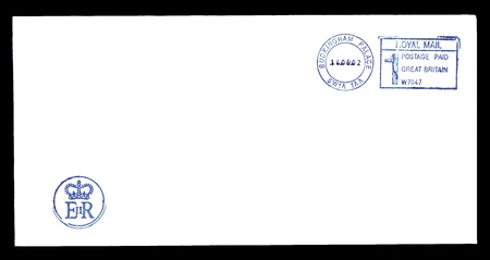 Blank postally used envelope from Buckingham Palace which is oficial residence of the Queen Elizabeth II with postmark and logo Stock Photo