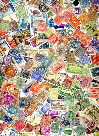 A pile of different postage stamps from around the world