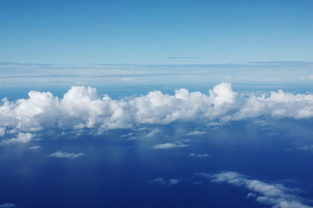 Sky scenery from airplane above sea and clouds