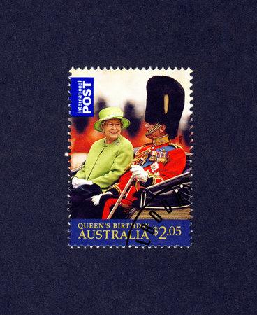 AUSTRALIA - CIRCA 2009  A postally used stamp printed in Australia shows Queen Elizabeth II and Prince Philip,Duke of Edinburgh in a open carriage, circa 2002