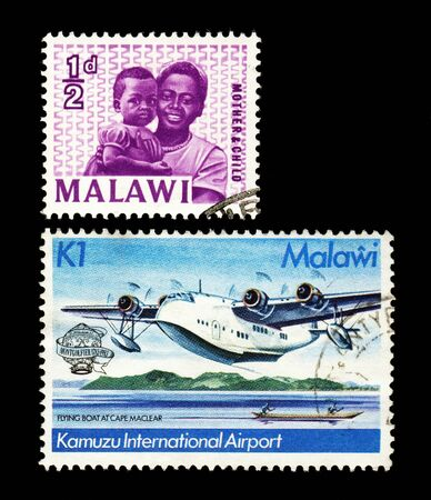 manned: MALAWI - CIRCA 1964  MALAWI - CIRCA 1983  Two postally used stamps printed in Malawi Violet stamp shows smiling African woman holding a child circa 1964 and other stamp shows a hydroplane landing or taking off above the sea issued to commemorate bicentena Editorial