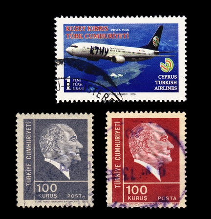 Three postally used stamps on black background.Stamp on the top - TRNC, TURKISH RESPUBLIC OF NORTHERN CYPRUS - CIRCA 2008 shows airplane, two other stamps TURKEY - CIRCA 1975 show portrait of Kemal Ataturk, the first President of Turkey Stock Photo - 13512755