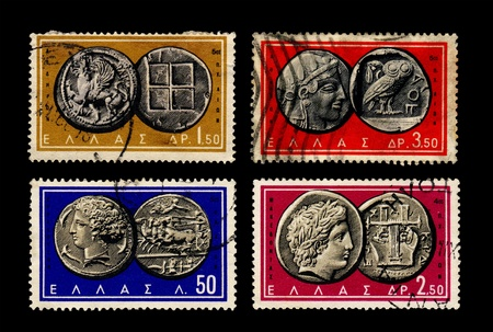 grecian: GREECE - CIRCA 1959-1963. Ancient Grecian coins from 3 - 5 centuries B.C. on stamps printed in Greece circa 1959 and 1963. Stock Photo