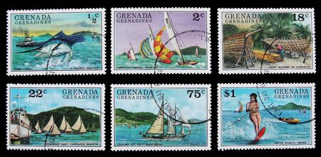 GRENADA - CIRCA 1976: Group of used postage stamps printed in Grenada showing people at different leisure activities on sea  circa 1976.