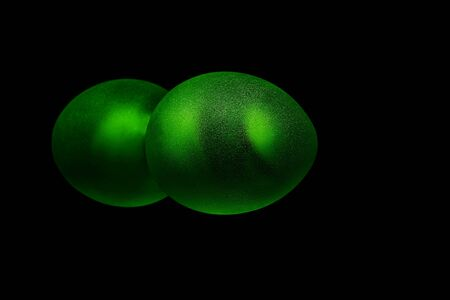 glow in the dark: Deep green color egg shaped round object with mirror reflection isolated on black background