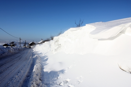 rural road: Rural road in winter after heavy snow near remote village