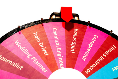 Spinning wheel isolated on white with different professions Stock Photo