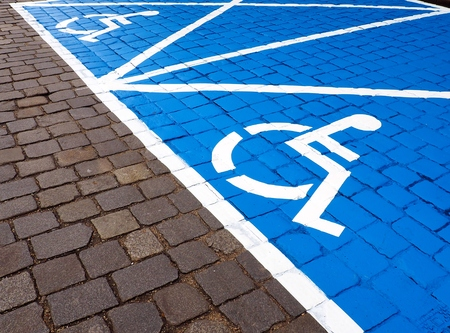 disadvantaged: Two parking spaces for disabled people painted on the street Stock Photo