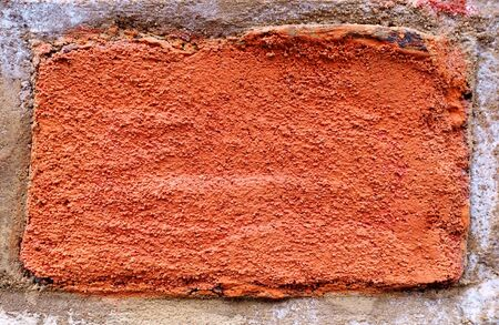Surface of red brick embedded into the wall - in close-up Stock Photo