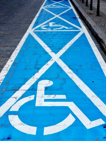 Three parking spaces for disabled people Stock Photo