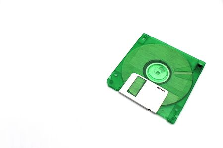 ​3 1⁄2 inch 1.44 MB floppy disk , green color disk , isolated