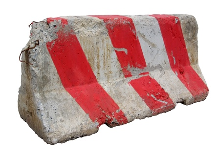 Red and white concrete barriers blocking the road. Isolated on white background Stock Photo