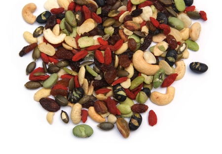 organic mixed nuts and dry fruits on white background