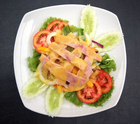 Ham Salad with vetgetable on white plate  photo
