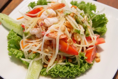 Paapaya Salad with Seafood on the leave of lettuce photo