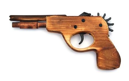 flint gun: Juguete pistola de madera para el ni�o, sobre un fondo blanco Foto de archivo