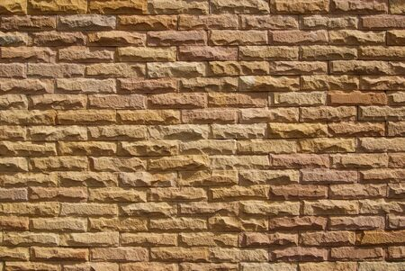 Sand stone wall surface, background of decorate photo