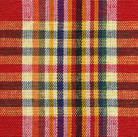 Red and yellow square fabric pattern background  photo