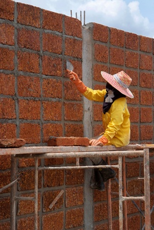 Worker is Constructing large wall with laterite brick  Stock Photo - 17091687