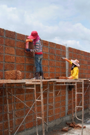 Workers are Constructing large wall with laterite brick  Stock Photo - 17091688