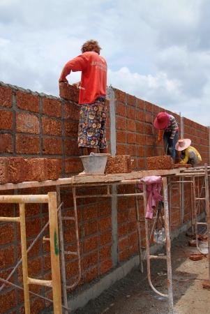 Bangkok  THAILAND - SEP 19   Unidentified Workers are Constructing large laterite brick wall on September 19, 2012 at Phutthamonthon Sai 3 in Bangkon, Thailand Stock Photo - 17091683
