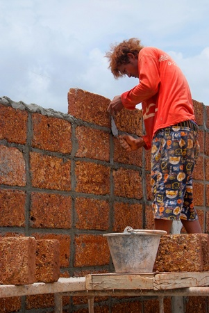 Bangkok  THAILAND - SEP 19   Unidentified  Worker is Constructing large laterite brick wall on September 19, 2012 at Phutthamonthon Sai 3 in Bangkon, Thailand Stock Photo - 17091685