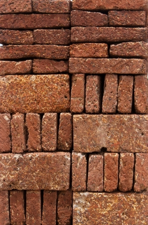 Pattern, Texture, Background of Red-brown Laterite bricks  Stock Photo