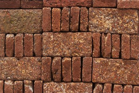 Pattern, Texture, Background of Red-brown Laterite bricks  photo