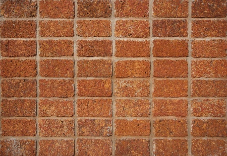 pattern red - brown color of modern style design decorative laterite stone wall surface with cement  photo