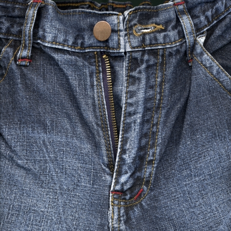 Fashion concept with trousers blue jeans close up photo