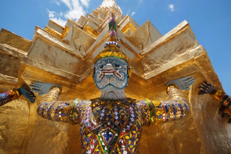 Giant statue of a beautiful Golden Pagoda in Wat Phra Kaew, Thailand  photo