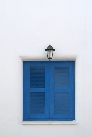 Vintage blue window on the white wall
