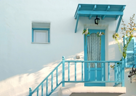 Vintage blue door and window and terrace Decorative with basket flowers on the white wall