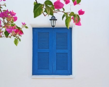 Vintage blue windows on the white wall  photo