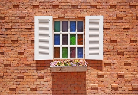 White window with flower pots on the brick wall background. Stock Photo - 20888728