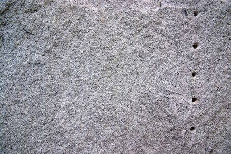 Round hole on the granite.The surface of Black and white granite stone. For texture background  photo