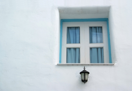 Vintage blue window on the white wall  photo