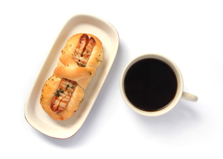 Appetizing sausage bread and cup of coffee  isolated on a white background  photo
