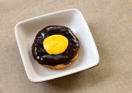 chocolate donut on plate isolated on a fabric