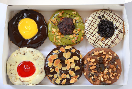 set of donuts in box close up  photo