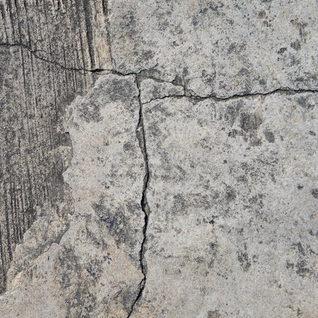 Composition of cracked concrete texture closeup background.  photo