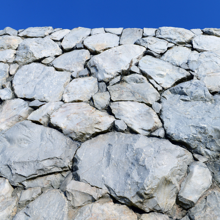 Stone wall background and texture with blue sky  Stock Photo - 25239785