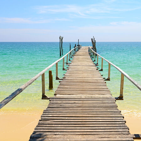 Wooden jetty on tropical beach, Samed island in Rayong province, East of Thailand.  photo